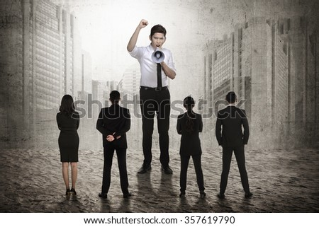Business leader command his subordinate using megaphone. Business leadership concept - stock photo