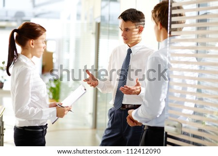 Business leader explaining to his employees their tasks