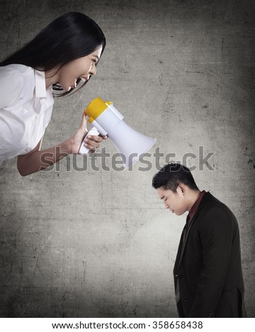 Business leader give order via megaphone to subordinate. Business communication concept - stock photo