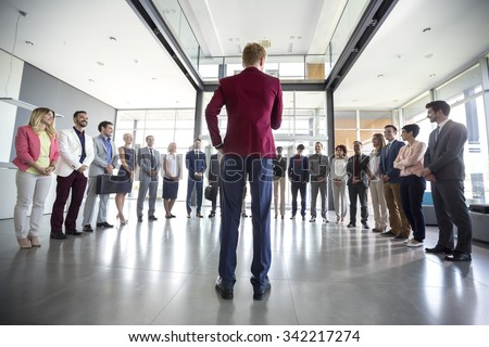 Business leader hold meeting with his team and tell them situation - stock photo