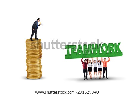 Business leader standing on a stack of golden coins and give order on his team, isolated on white - stock photo