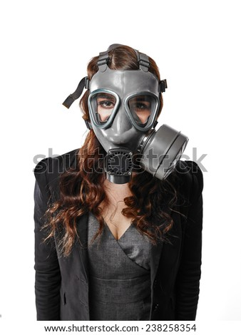 Business looking young adult woman posing on a personal gas mask on her face - white background - stock photo