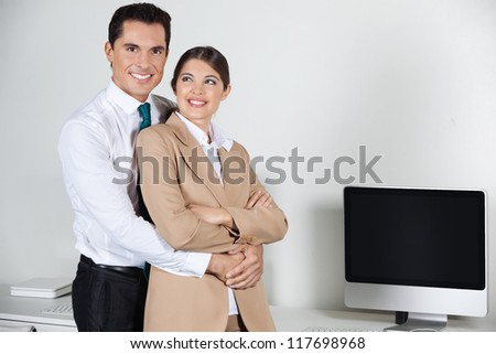 Business love affair in the office with a manager and a secretary - stock photo