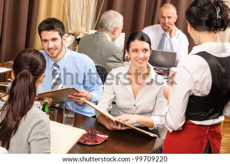 Business lunch executive people looking menu  waitress taking order restaurant - stock photo