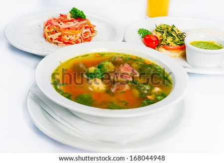 Business lunch on a white background, three dishes - stock photo