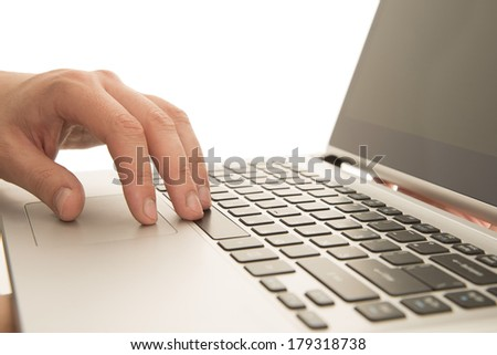 Business male hands writing on white laptop Isolated on white background man using a computer whilst holding in hand