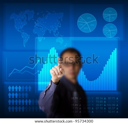 business man access graphic data on modern computer touchscreen - stock photo