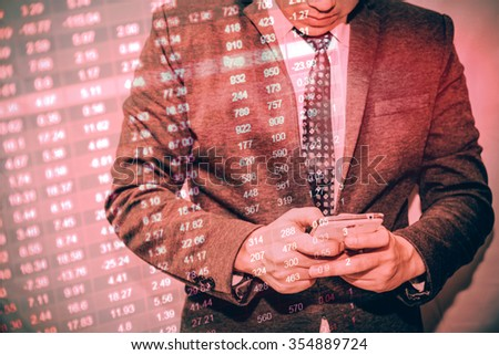Business man action against candle stick graph chart of stock market investment trading, monotone color, Bullish point, Bearish point. trend of graph.  - stock photo