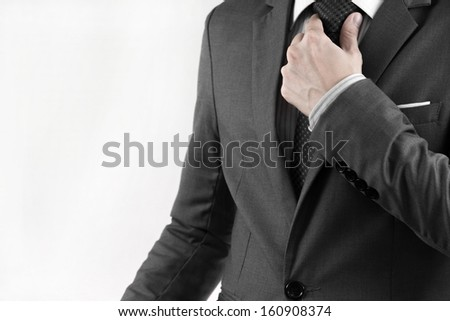 Business man adjusting his necktie. isolated on white - stock photo