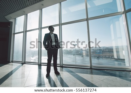 Business man  against panoramic windows