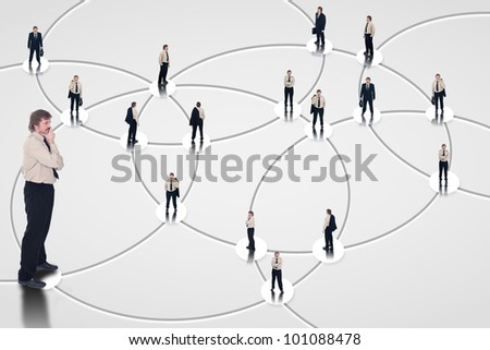 Business man analyzing social networking for business opportunities - stock photo