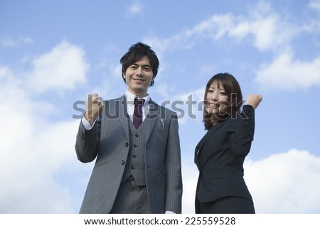 Business man and business woman show the guts pose - stock photo