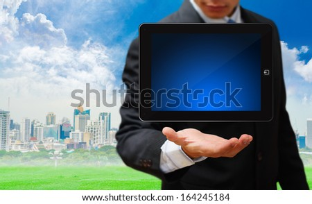 Business man and digital tablet  - stock photo