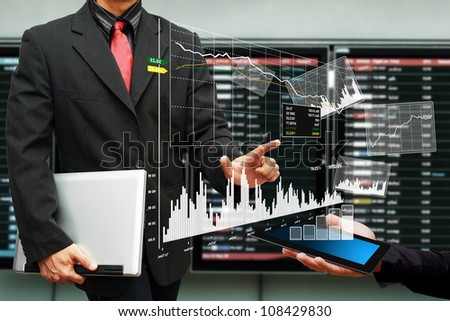Business man and graph report on digital tablet - stock photo