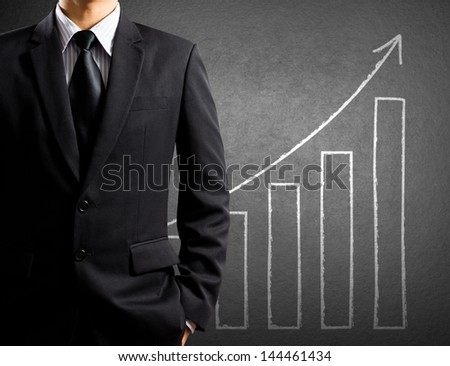 Business man and growth chart - stock photo