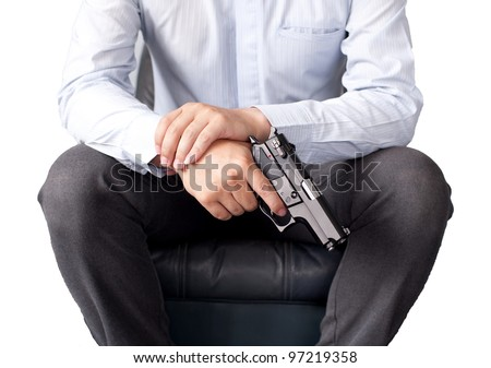 business man and gun - stock photo