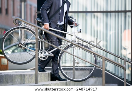 thumb1.shutterstock.com/display_pic_with_logo/434191/248714917/stock-photo-business-man-and-his-bicycle-concept-bike-go-to-work-248714917.jpg
