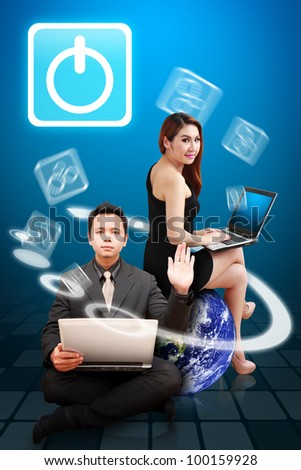Business man and lady present the power icon from Globe : Elements of this image furnished by NASA - stock photo