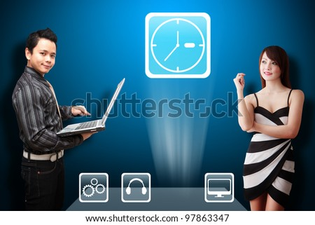 Business man and secretary look at the Clock icon