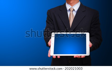 Business man and touch pad