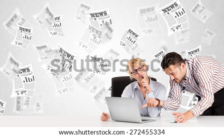 Business man and woman at desk with stock market newspapers concept - stock photo