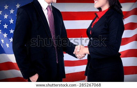 Business man and woman hand shake with USA flag on the background. Business in USA conceptual - stock photo