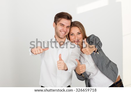 Business man and woman in white happy