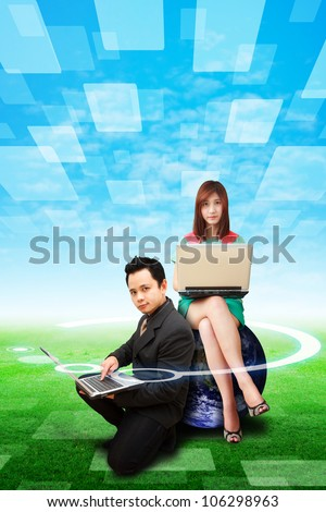 Business man and woman on grass field : Elements of this image furnished by NASA