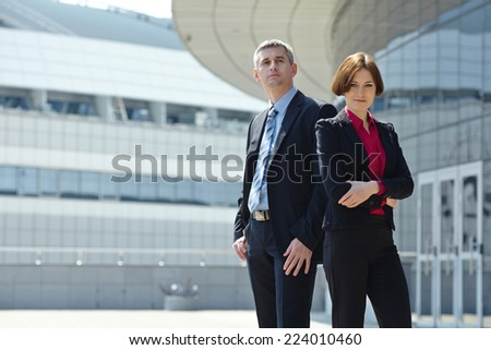 Business man and woman outdoor - stock photo