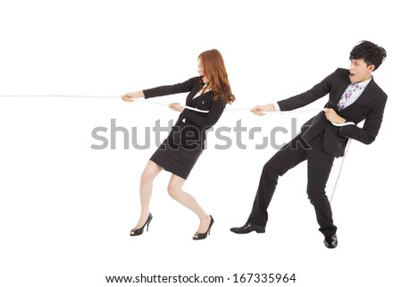 business man and woman playing tug of  war - stock photo