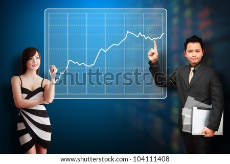Business man and woman present the Graph report