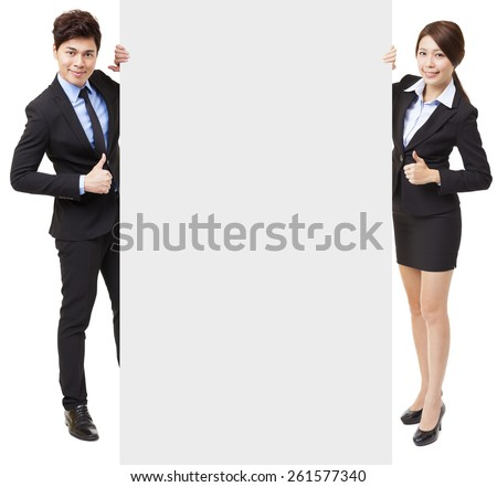 business man and woman showing the empty board with thumbs up - stock photo