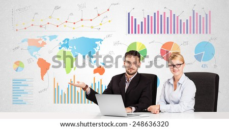 Business man and woman with colorful charts graphs - stock photo
