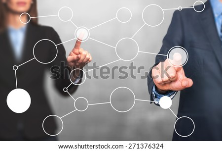 business man and women hand drawing blank flow chart on new modern computer as concept. Isolated on grey. Stock Image - stock photo