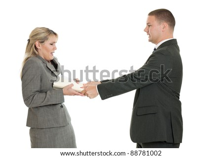 Business man angrily handing a folder to a business woman isolated on a white background - stock photo