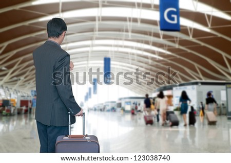 Business man at airport - stock photo