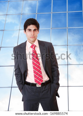 Business man at corporate building - stock photo