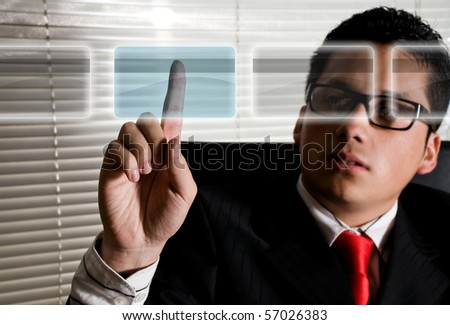 Business man at office choosing credit card for online payment - stock photo