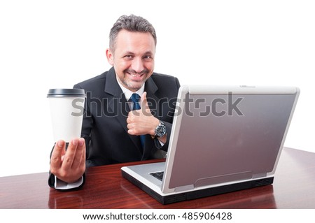 Business man at office holding coffe showing thumb up gesture and smiling isolated on white background