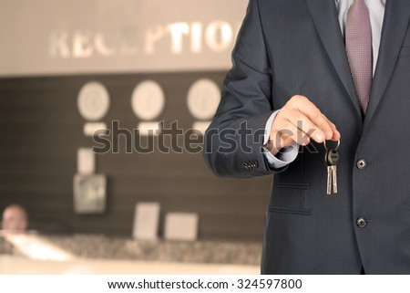 Business man at the reception giving keys