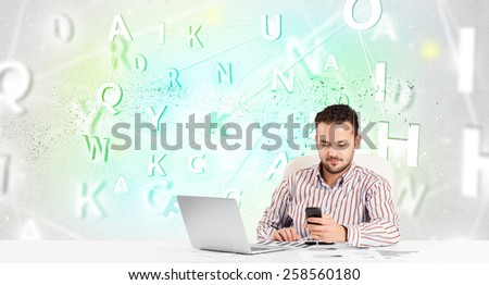 Business man at white desk with green word cloud - stock photo