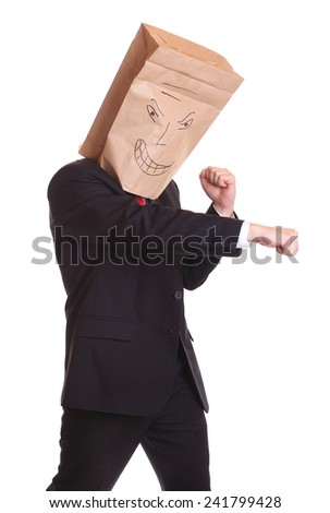 Business man bag on his head isolated on white ready to fight - stock photo
