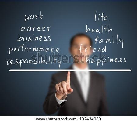 business man balance his work and life on finger tip - stock photo