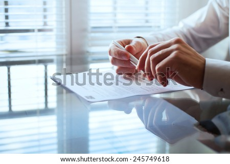 business man before signing contract - stock photo