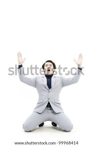 business man begging - stock photo