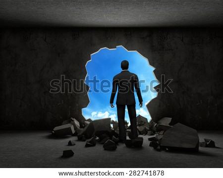 business man breaking trough a wall - stock photo