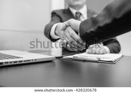 Business Man. Business handshake and business people ,  black and white - stock photo
