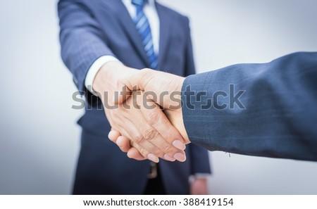 Business Man. Business handshake and business people. handshake Business concept. Shake hands after their meeting. man handshake. Shake hands on white background.   - stock photo