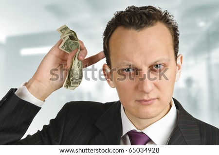 Business man calculating money in his mind - stock photo