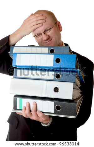business man carries a stack of ring binders - stock photo